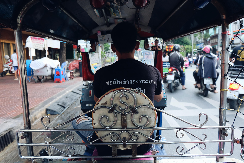 Tuk tuk ride through streets of Bangkok Thailand
